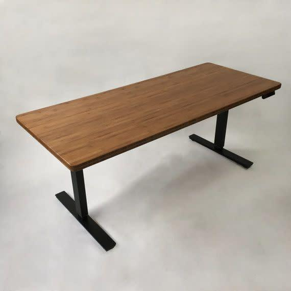This desk raises smoothly with the touch of a button, from sitting to standing, so you can have your preferred height every time.<span>Shop it here</span>.