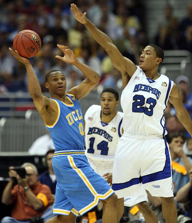 UCLA's Russell Westbrook (0) attempts to pass against Memphis' Derrick Rose during first half action in an NCAA Men's Basketball Championship Final Four semi-final game at the Alamodome in San Antonio, Texas, Saturday, April 5, 2008. (Photo by Ron T. Ennis/Fort Worth Star-Telegram/MCT via Getty Images)