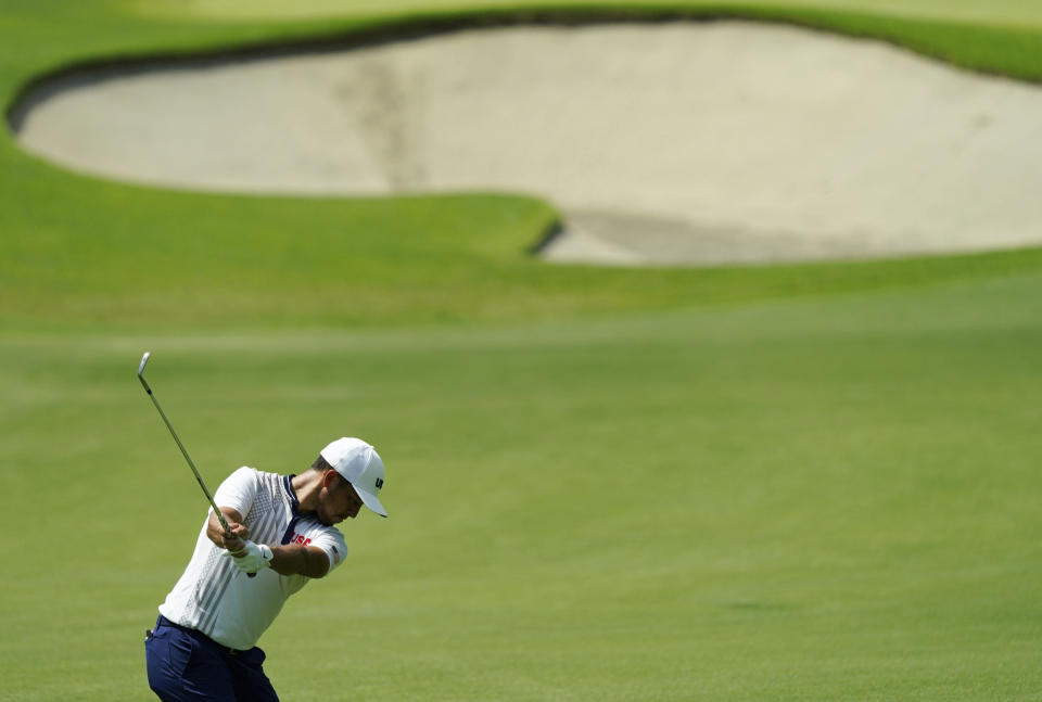 Xander Shauffele of United States plays a shot from the 9th fairway during the third round of the men's golf event at the 2020 Summer Olympics on Saturday, July 31, 2021, in Kawagoe, Japan. (AP Photo/Matt York)
