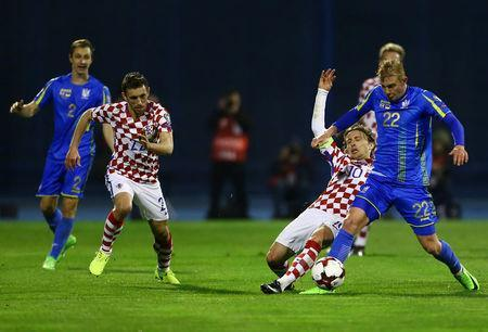 Football Soccer - Croatia v Ukraine - 2018 World Cup Qualifiers European Zone - Maksimir arena, Zagreb, Croatia - 24/03/17. Ukraine's Viktor Kovalenko and Croatia's Luka Modric in action. REUTERS/Antonio Bronic