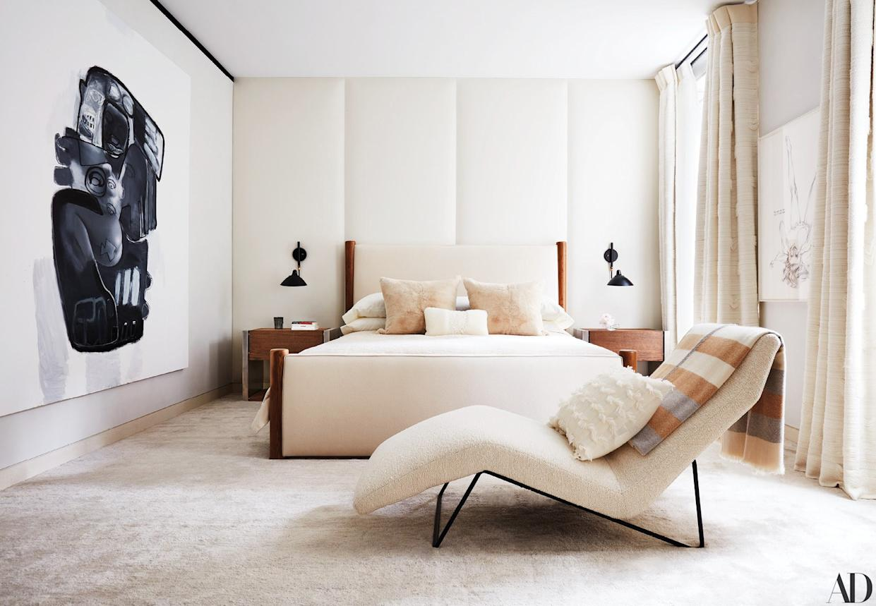 """<div class=""""caption""""> In the master bedroom, a Chapas textiles fabric covers a vintage Carlo Hauner chaise longue, and a Kohro fabric covers the Jacques Adnet bed. The custom side tables are by Ingrao in collaboration with Based Upon; artworks by Richard Prince (left) and Lutz Bacher. </div>"""