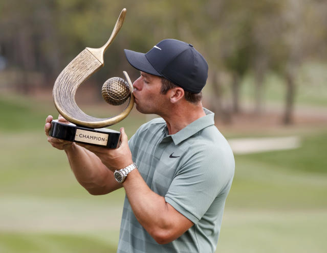 Paul Casey kisses the champion's trophy after winning the Valspar Championship golf tournament Sunday, March 11, 2018, in Palm Harbor, Fla. (AP Photo/Mike Carlson)