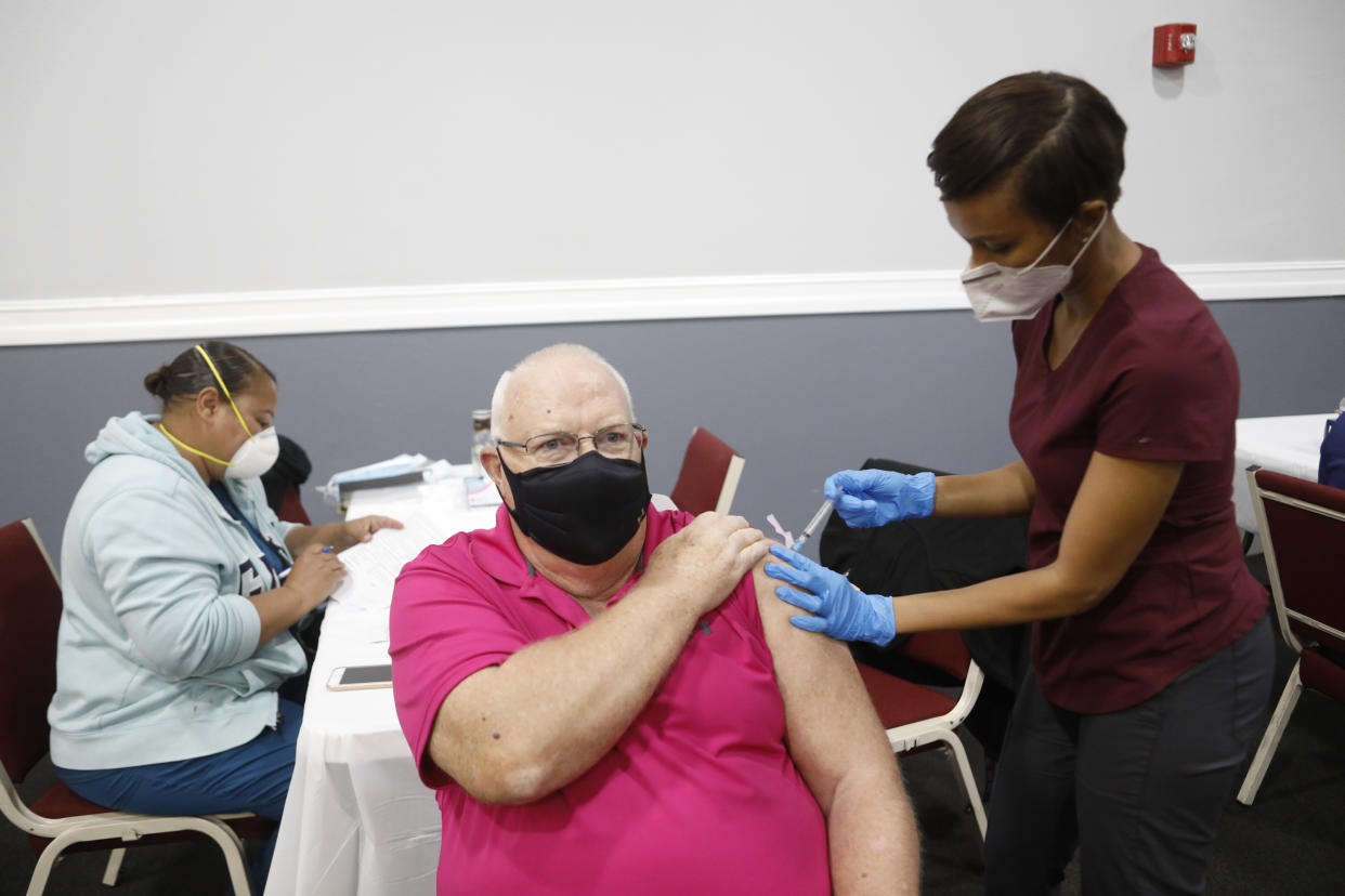 A pensioner is vaccinated in Tampa, Florida.