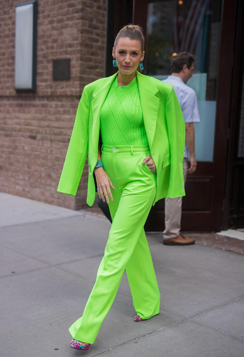 <p>Wearing a highlighter-green Versace trouser suit to promote her new film, the actress proved that neon is back. <em>[Photo: Getty]</em> </p>