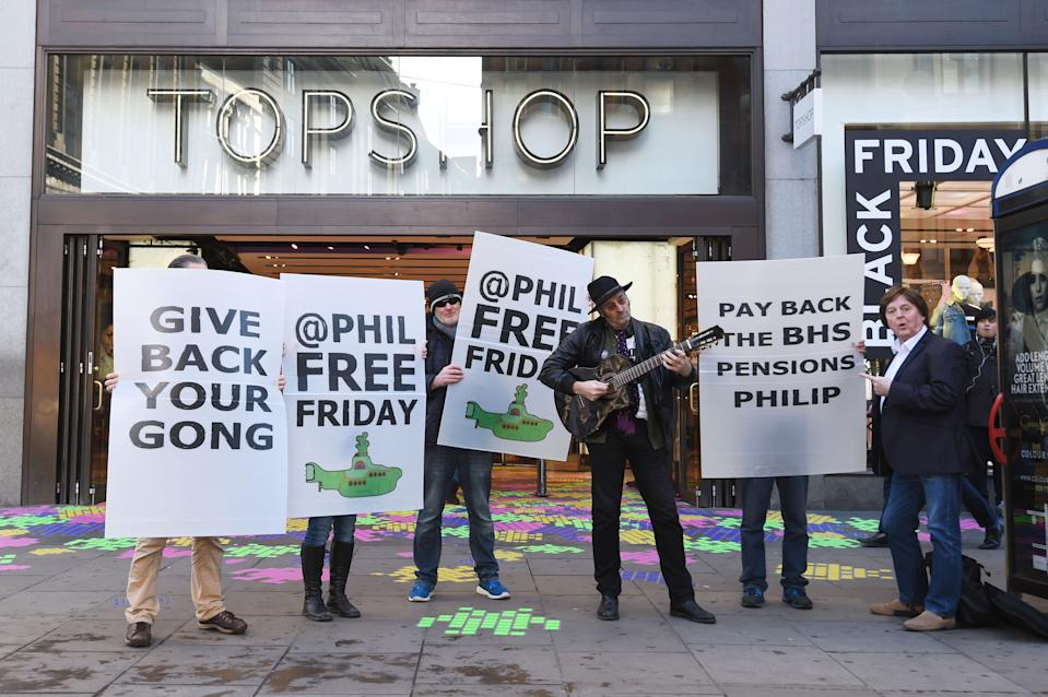 Protesters let by musician Homesick Mick (third right) outside Topshop in Oxford Circus, London, demonstrate against Sir Philip Green in a campaign called #phillipfreefriday asking shoppers on Black Friday to boycott his stores in an effort to persuade the billionaire to pay the lost BHS pensions back to his former staff.