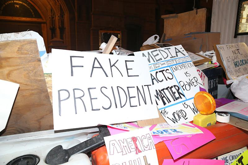 Discarded signs from Women's March sit in pile near a construction in New York City on Jan. 21, 2017. (Photo: Gordon Donovan/Yahoo News)