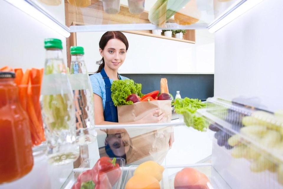 """No one needs <em>that </em>many """"save the dates"""" and school pictures on their fridge. If you can barely tell what color yours is, it's time to clean it off and better organize what you <em>do </em>have. Get rid of the junk and create designated sections to keep track of your grocery list, to-do list, and other things you need to remember throughout the week."""