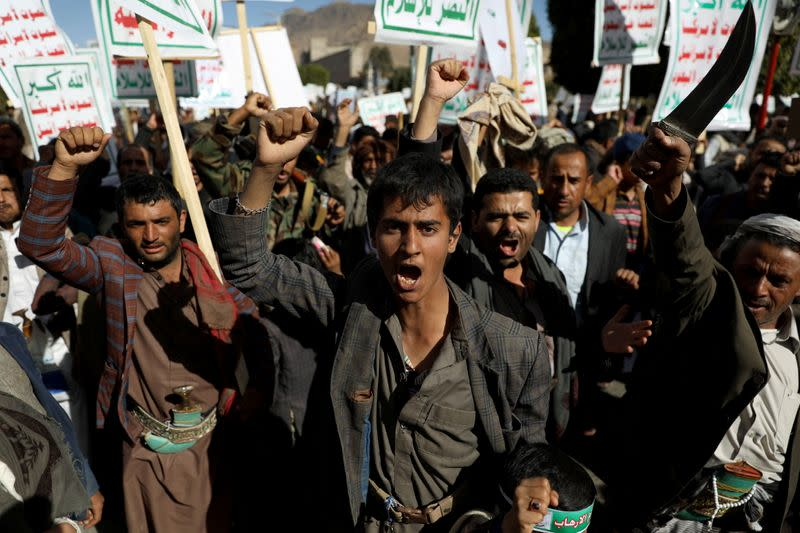 Houthi supporters rally against the United States' designation of Houthis as a foreign terrorist organisation, in Sanaa,