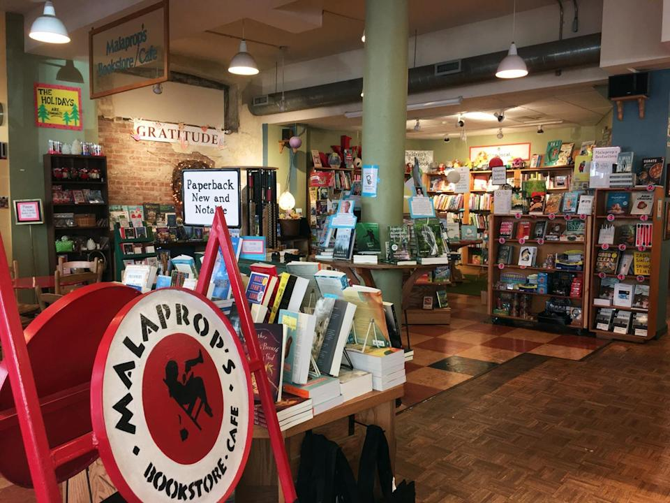 """<p>""""The Paris of the South"""" wouldn't be """"The Paris of the South"""" without a <a rel=""""nofollow noopener"""" href=""""http://www.malaprops.com/"""" target=""""_blank"""" data-ylk=""""slk:first-rate bookstore"""" class=""""link rapid-noclick-resp"""">first-rate bookstore</a>. Located in the heart of downtown Asheville, Malaprop's Bookstore & Café stands at the vanguard of literary culture. Established in 1982 by Emoke B'Racz, a political exile from Hungary, the store publishes its own newsletter, produces its own podcast, and frequently hosts book signings, author readings, and book clubs. In Malaprops, one of the South's most literary cities has found its reflection.</p>"""