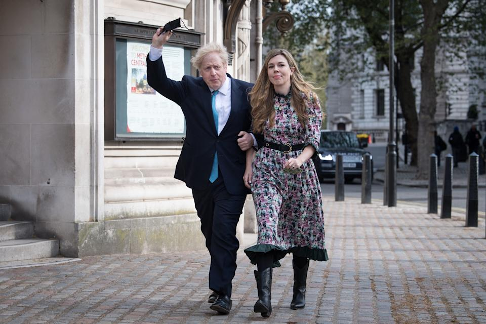 Prime Minister Boris Johnson and his fiancee Carrie Symonds arrive to cast their vote at Methodist Central Hall, central London, in the local and London Mayoral election. Picture date: Thursday May 6, 2021.