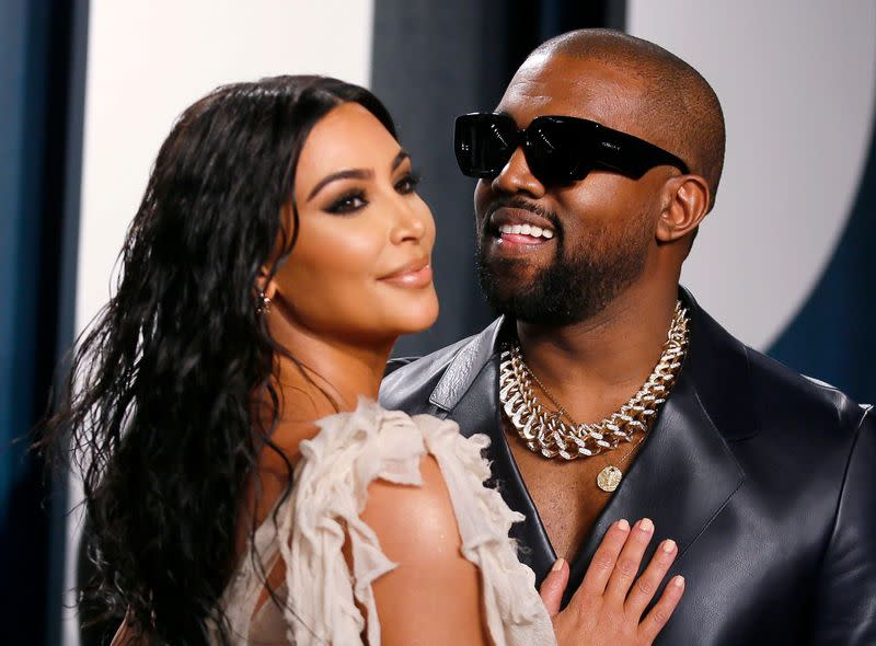 Kim Kardashian and Kanye West attend the Vanity Fair Oscar party in Beverly Hills during the 92nd Academy Awards, in Los Angeles