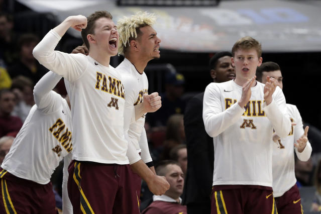 Minnesota bench celebrate after Minnesota's Jordan Murphy scores a basket during the second half of an NCAA college basketball game against Purdue in the quarterfinals of the Big Ten Conference tournament, Friday, March 15, 2019, in Chicago. (AP Photo/Nam Y. Huh)