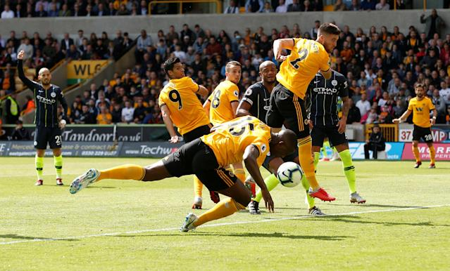 Willy Boly diverts the ball into Manchester City's net with his arm at Molineux