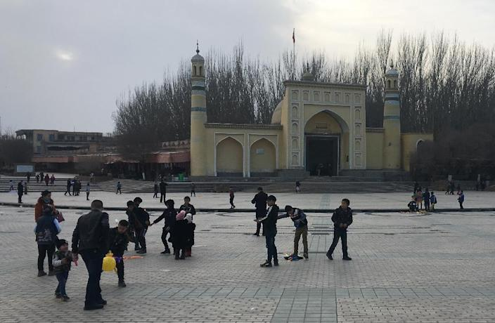 Children play outside a mosque in Kashgar, in China's western Xinjiang region, where a crackdown after 2009 violence is aimed at suppressing separatism (AFP Photo/BEN DOOLEY)