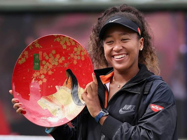 Naomi Osaka holds athe trophy aloft after winning the Pan Pacific Open in Osaka (AFP Photo/Jiji Press)