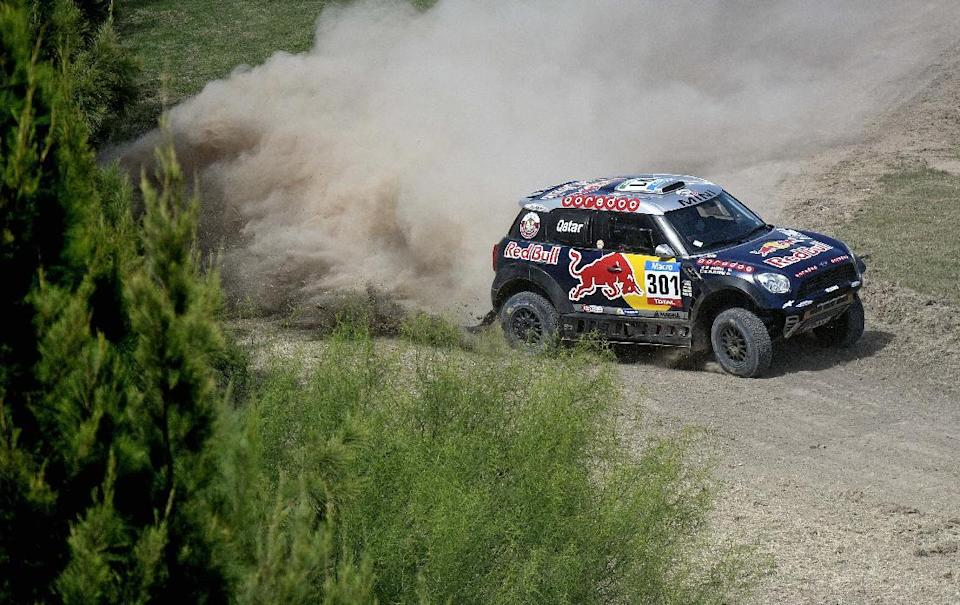 Mini's driver Nasser Al-Attiyah of Qatar and co-driver Mathieu Baumel of France compete during the 2015 Dakar Rally stage 1 between Buenos Aires and Villa Carlos Paz, Argentina, on January 4, 2015 (AFP Photo/Franck Fife)