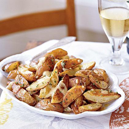"""<p>While raw garlic is pungent, roasted garlic is sweet and mild with a buttery texture. Roast extra garlic for our Roasted Garlic Pizza. Serve this warm twist on potato salad as a <a href=""""https://www.myrecipes.com/course/side-dish-recipes/sides-for-steak"""" rel=""""nofollow noopener"""" target=""""_blank"""" data-ylk=""""slk:side dish with steak"""" class=""""link rapid-noclick-resp"""">side dish with steak</a> or roast chicken.</p>"""