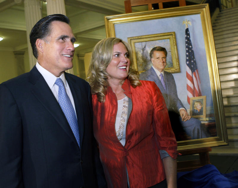 "FILE - In this June 30, 2009, file photo, former Massachusetts Gov. Mitt Romney and his wife, Ann, greet guests after his official portrait is unveiled during a ceremony on the Grand Staircase at the Statehouse in Boston. Romney's portrait was painted by New Hampshire artist Richard Whitney for $30,000 in private donations and will hang in the lobby of the third-floor Governor's Office.  To the yearbook editors at the all-girl Kingswood School, Ann Lois Davies' destiny seemed pretty obvious. ""The first lady,"" the entry beside the stunning blond beauty's photo in the 1967 edition of ""Woodwinds"" concluded. ""Quiet and soft spoken."" The modern feminist movement was just dawning, and even some of the girls at the staid prep school in the wealthy Detroit suburb of Bloomfield Hills were feeling their oats _ if in a somewhat tame way. Charlon McMath Hibbard remembers getting a doctor's note about her feet, so she wouldn't have to wear the obligatory saddle Oxfords. (AP Photo/Elise Amendola, File)"