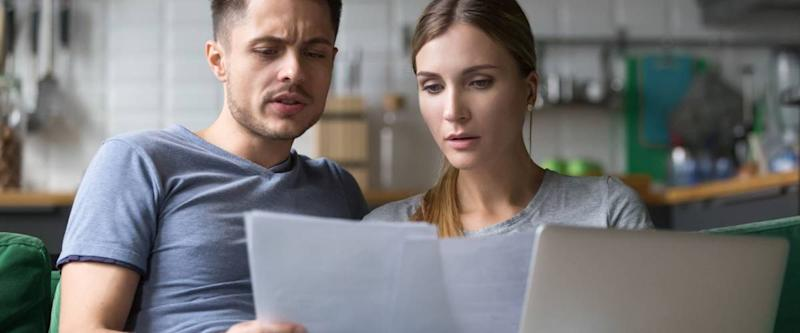 Couple comparing credit histories