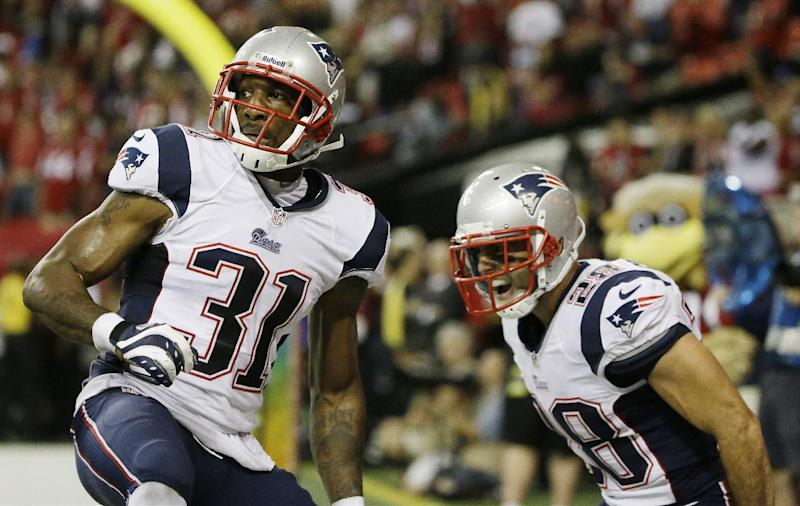 New England Patriots cornerback Aqib Talib (31) and New England Patriots strong safety Steve Gregory (28) react after Talib broke up the last Atlanta Falcons pass during the second half of an NFL football game, Sunday, Sept. 29, 2013, in Atlanta. The New England Patriots won 30-23. (AP Photo/David Goldman)