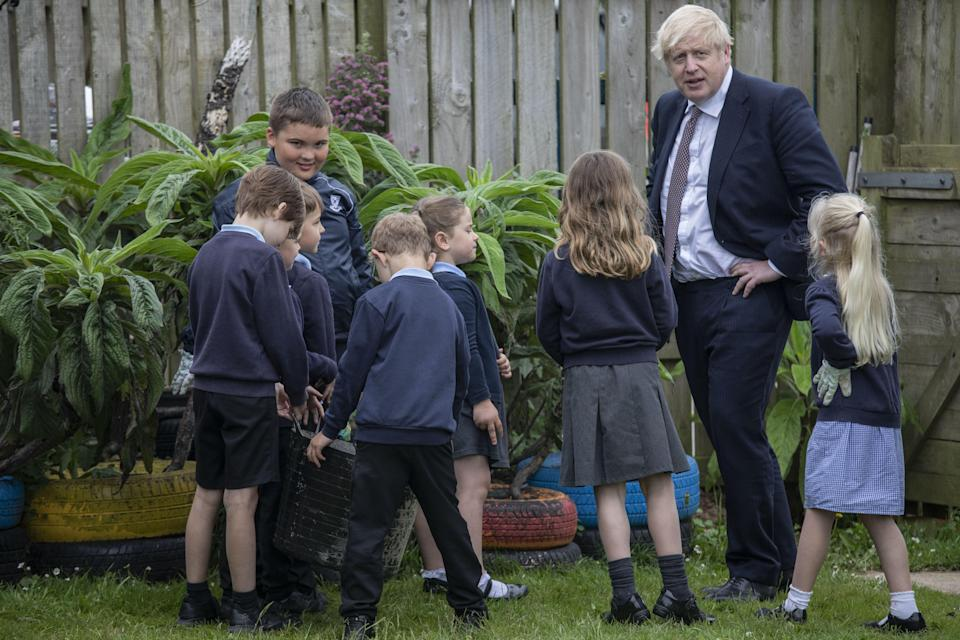 Prime Minister Boris Johnson talks with primary school children in Cornwall (Jack Hill/The Times/PA) (PA Wire)