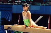 """<p>My absolute favorite routine from Nationals, and, in my opinion, the best scene from the film, is Wei Wei's (Nikki SooHoo) beam routine. The gymnasts - except for Tricia (Tarah Paige) - all scratch so that Wei Wei can medal on the event. She wows everyone by showcasing a hip-hop routine with head spins and awesome dance moves (even the worm!) set to <strong>Come Baby Come</strong> by K7. It's so <em>not </em>what elite gymnastics routines are like in real life, and I think about it at least once a week even now. <a href=""""http://www.youtube.com/watch?v=Cz95WDzQ1Tk"""" class=""""link rapid-noclick-resp"""" rel=""""nofollow noopener"""" target=""""_blank"""" data-ylk=""""slk:Watch the routine here."""">Watch the routine here.</a></p>"""