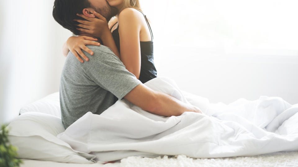 passionate couple is having sex on bed