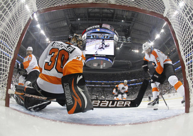 PITTSBURGH, PA - APRIL 20: Scott Hartnell #19 of the Philadelphia Flyers clears the puck from the crease as Ilya Bryzgalov #30 protects the net against the Pittsburgh Penguins in Game Five of the Eastern Conference Quarterfinals during the 2012 NHL Stanley Cup Playoffs at Consol Energy Center on April 20, 2012 in Pittsburgh, Pennsylvania. (Photo by Justin K. Aller/Getty Images)