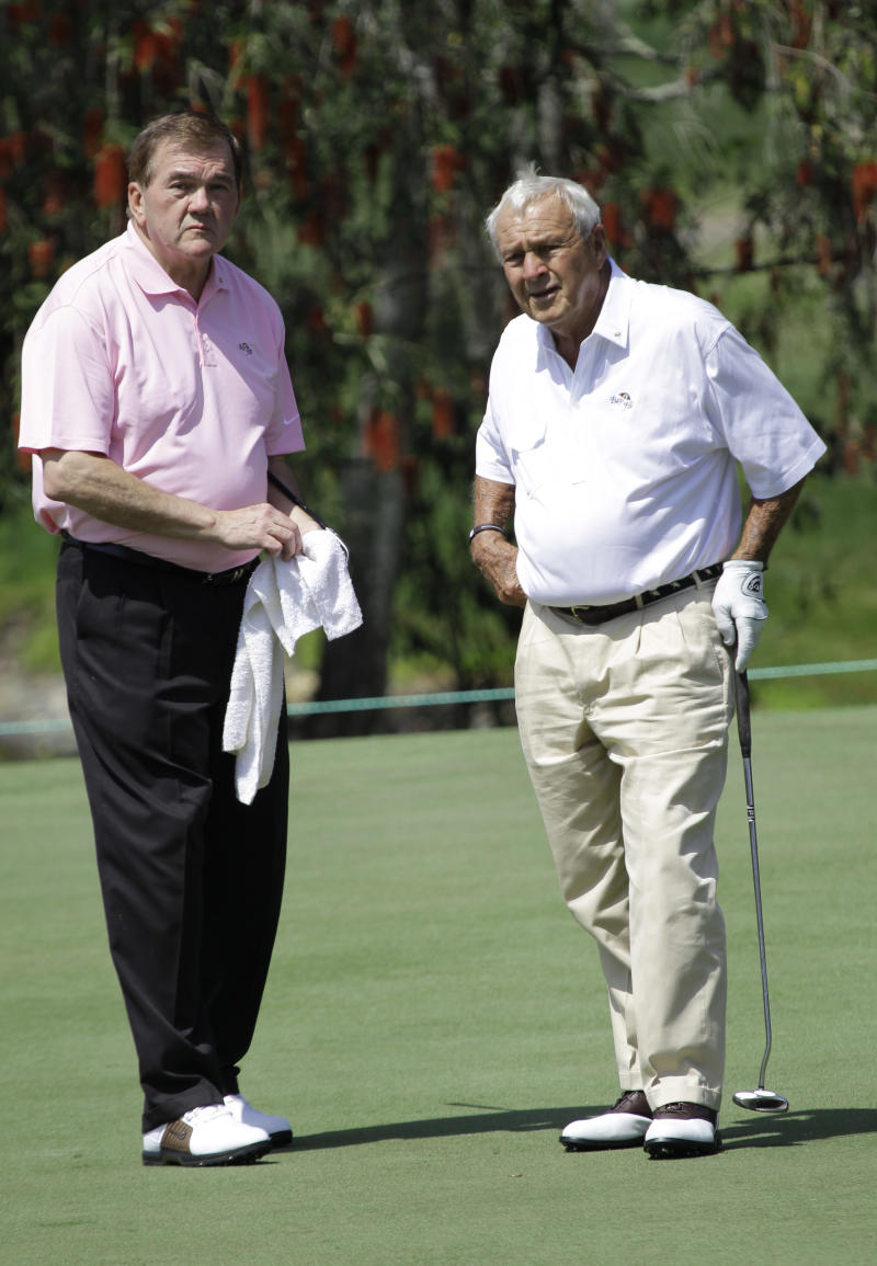 Arnold Palmer, right, waits for his turn to putt on the second green with former Secretary of Homeland Security Tom Ridge, during the Pro-Am competition at the Arnold Palmer Invitational golf tournament in Orlando, Fla., Wednesday, March 23, 2011. Ridge was Palmer's caddie for the event. (AP Photo/John Raoux)