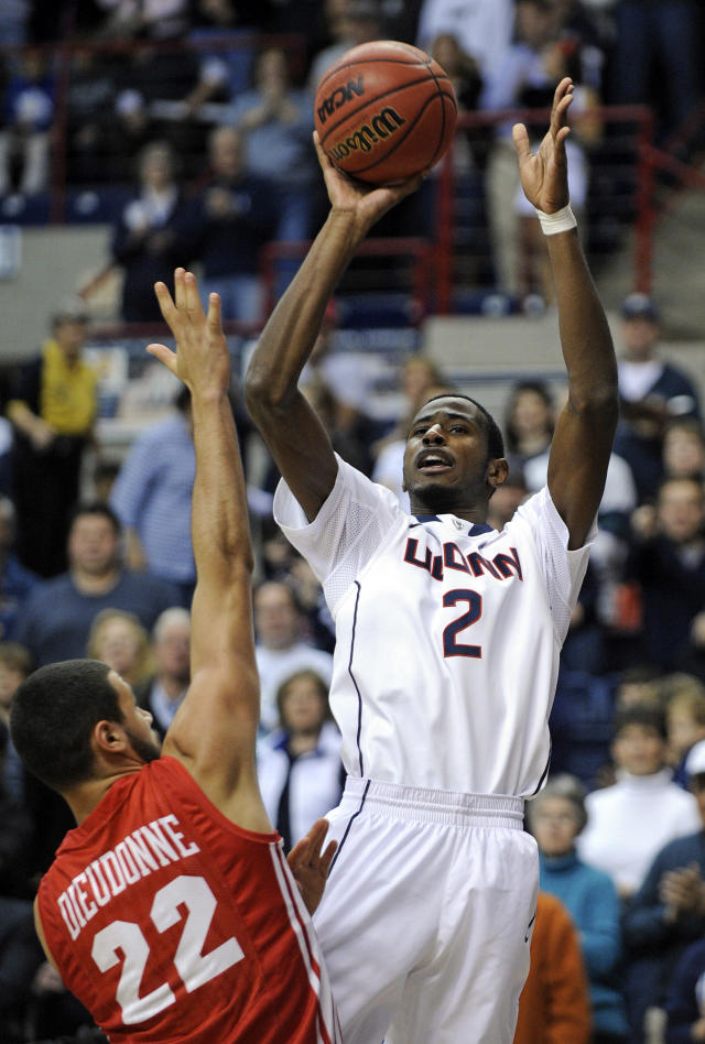 Connecticut's DeAndre Daniels (2) goes up for a shot while being guarded by Boston University's Nathan Dieudonne (22) during the first half of an NCAA college basketball game in Storrs, Conn., on Sunday, Nov. 17, 2013. (AP Photo/Fred Beckham)