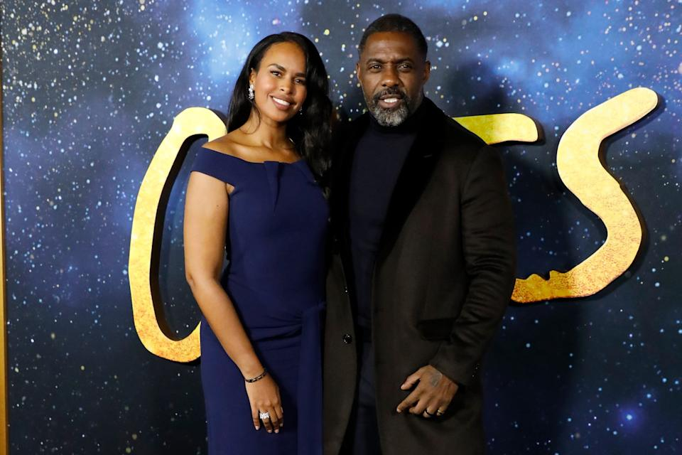 NEW YORK, NEW YORK - DECEMBER 16: Sabrina Dhowre and Idris Elba attend the world premiere of