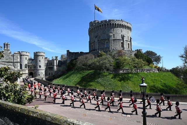 The Foot Guards Band are seen marching into position ahead of the funeral of the Duke of Edinburgh at Windsor Castle, Berkshire