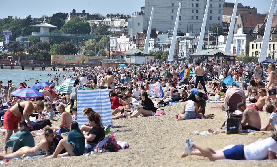 SOUTHEND-ON-SEA, ENGLAND - MAY 25: Crowds of people gather on the beach on a warm and sunny May Day bank holiday on May 25, 2020 in Southend-on-Sea, United Kingdom. The British government has started easing the lockdown it imposed two months ago to curb the spread of Covid-19, abandoning its 'stay at home' slogan in favour of a message to 'be alert', but UK countries have varied in their approaches to relaxing quarantine measures. (Photo by John Keeble/Getty Images)