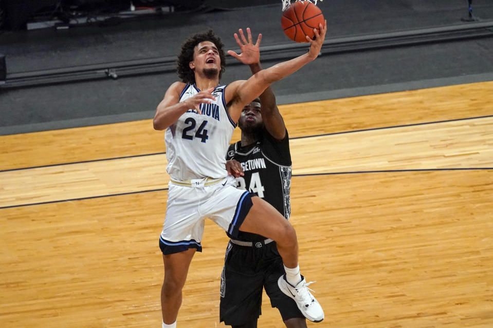 Villanova forward Jeremiah Robinson-Earl (24) goes to the basket ahead of Georgetown center Qudus Wahab (34) during the second half of an NCAA college basketball game in the quarterfinals of the Big East conference tournament, Thursday, March 11, 2021, in New York. Georgetown won 72-71. (AP Photo/Mary Altaffer)