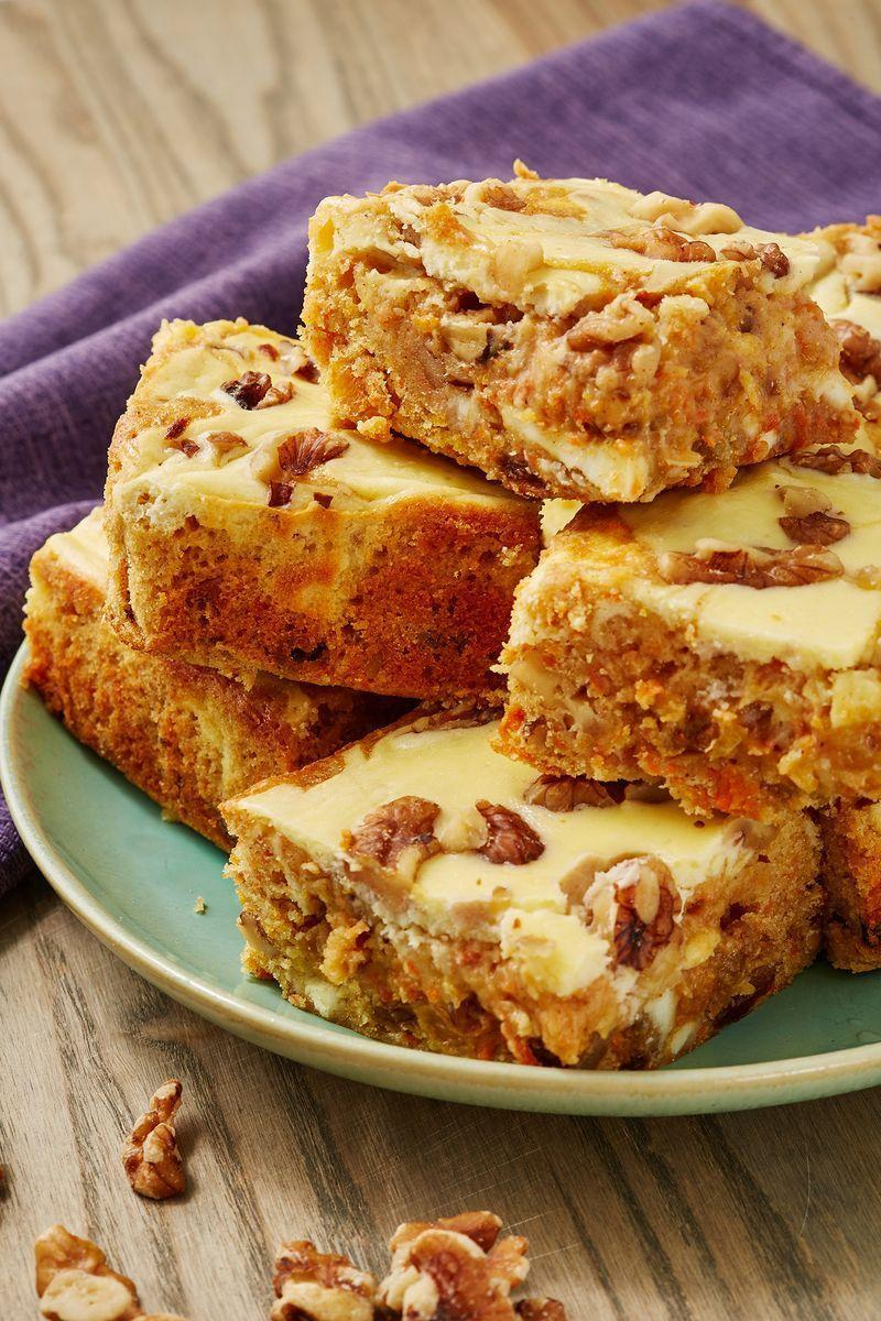 "<p>All your favourite <a href=""https://www.delish.com/uk/cooking/recipes/a28826709/carrot-cake-banana-bread-recipe/"" rel=""nofollow noopener"" target=""_blank"" data-ylk=""slk:carrot cake"" class=""link rapid-noclick-resp"">carrot cake</a> flavours transformed into one delectable <a href=""https://www.delish.com/uk/cooking/recipes/a30713621/reeses-peanut-butter-blondies-recipe/"" rel=""nofollow noopener"" target=""_blank"" data-ylk=""slk:blondie"" class=""link rapid-noclick-resp"">blondie</a> complete with cream cheese swirl! If you're a carrot cake purist, you can leave out the walnuts and sultanas.</p><p>Get the <a href=""https://www.delish.com/uk/cooking/recipes/a31190492/carrot-cake-blondies/"" rel=""nofollow noopener"" target=""_blank"" data-ylk=""slk:Carrot Cake Blondies"" class=""link rapid-noclick-resp"">Carrot Cake Blondies</a> recipe. </p>"