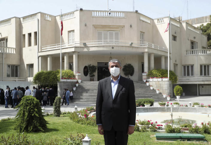 In this photo released by the official website of the office of the Iranian Presidency, then Minister of Road and Urbanization Mohammad Eslami, poses for a photo in the presidency compound, April 7, 2021, in Tehran, Iran. On Sunday Aug. 29, 2021, Iranian President Ebrahim Raisi appointed Eslami as the new director of the country's nuclear department, replacing Ali Akbar Salehi, a U.S.-educated prominent nuclear scientist. (Office of the Iranian Presidency via AP)