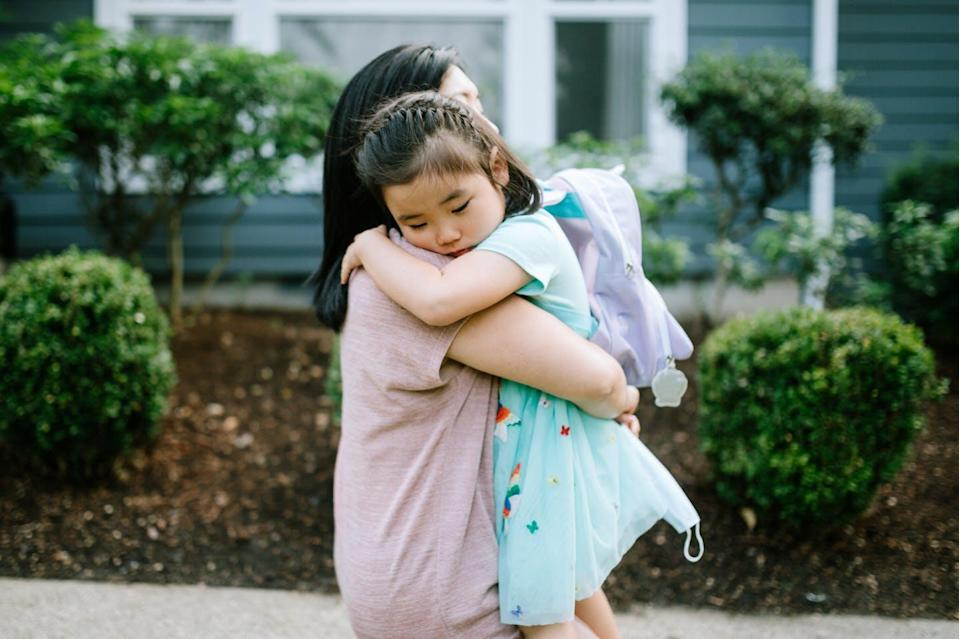"""<span class=""""caption"""">Eight out of 10 Asian American youths reported being bullied and harassed during the pandemic.</span> <span class=""""attribution""""><a class=""""link rapid-noclick-resp"""" href=""""https://www.gettyimages.com/detail/photo/girl-hugs-her-mother-on-first-day-of-school-royalty-free-image/1278034168?adppopup=true"""" rel=""""nofollow noopener"""" target=""""_blank"""" data-ylk=""""slk:RyanJLane/E+ via Getty Images"""">RyanJLane/E+ via Getty Images</a></span>"""