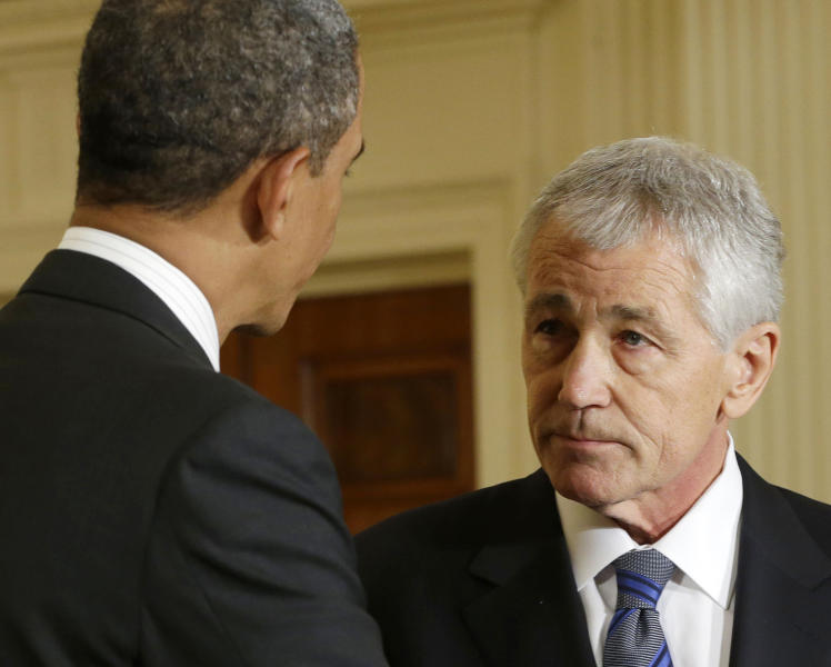 FILE - In this Jan. 7, 2013 file photo, President Barack Obama shakes hands with Defense Secretary-nominee, former Nebraska Sen. Chuck Hagel, in the East Room of the White House in Washington. Hagel says his months fighting in Vietnam alongside his brother Tom shaped his view of what it's like to be a soldier in war, an experience that will inform his work if the Senate confirms him to be defense secretary. While Hagel, who was twice wounded, suggests caution when using military force, he also adopts a hard line toward Iran. His nomination hearings begin Thursday. (AP Photo/Pablo Martinez Monsivais. File)