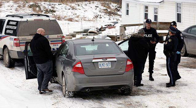 Toronto police forensic officers stand outside a house in Madoc, Ontario. Source: AP