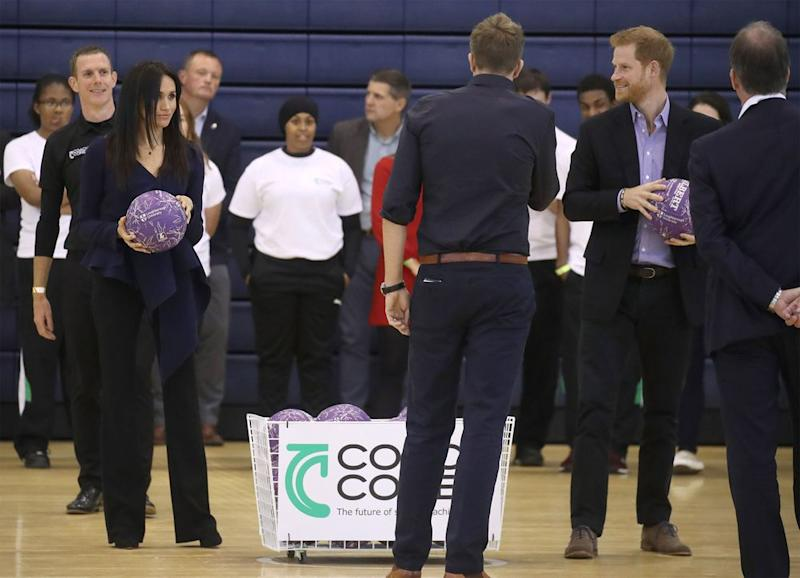 Meghan Markle plays netball in FOUR-INCH HEELS with Prince Harry