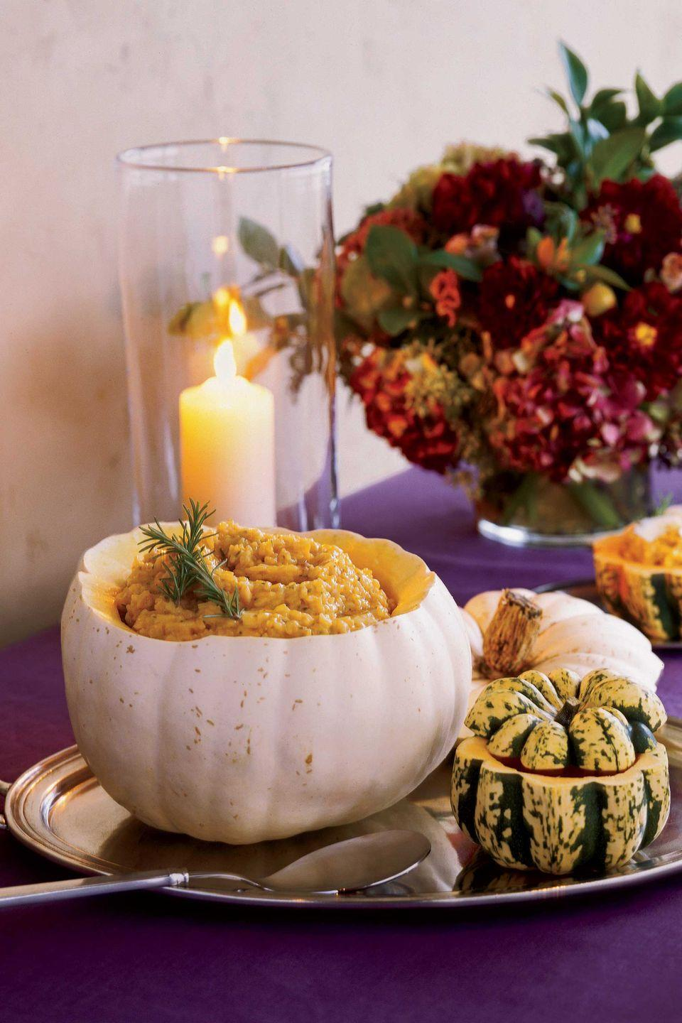 """<p>Panettone stuffing and roasted pumpkin risotto are tasty dishes, especially when served in festive hollowed-out gourds.</p><p><strong><a href=""""https://www.countryliving.com/food-drinks/recipes/a1991/pumpkin-risotto-butter-clv1107/"""" rel=""""nofollow noopener"""" target=""""_blank"""" data-ylk=""""slk:Get the recipe"""" class=""""link rapid-noclick-resp"""">Get the recipe</a>.</strong></p>"""