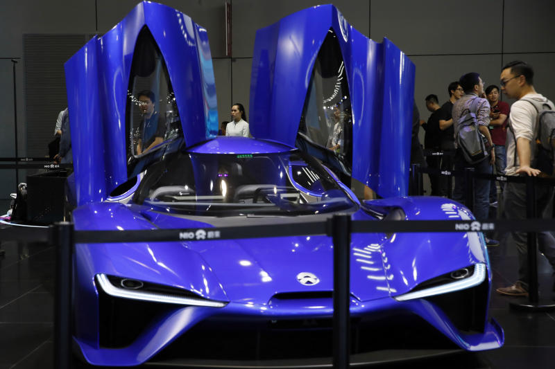 In this photo taken Wednesday, April 19, 2017, visitors look at the $1.5million NIO EP9 displayed at the Shanghai auto show. NIO is part of a wave of fledgling automakers - all backed at least in part by Chinese investors - that are propelling the electric vehicle industry's latest trend: ultra-high-performance cars. (AP Photo/Ng Han Guan)