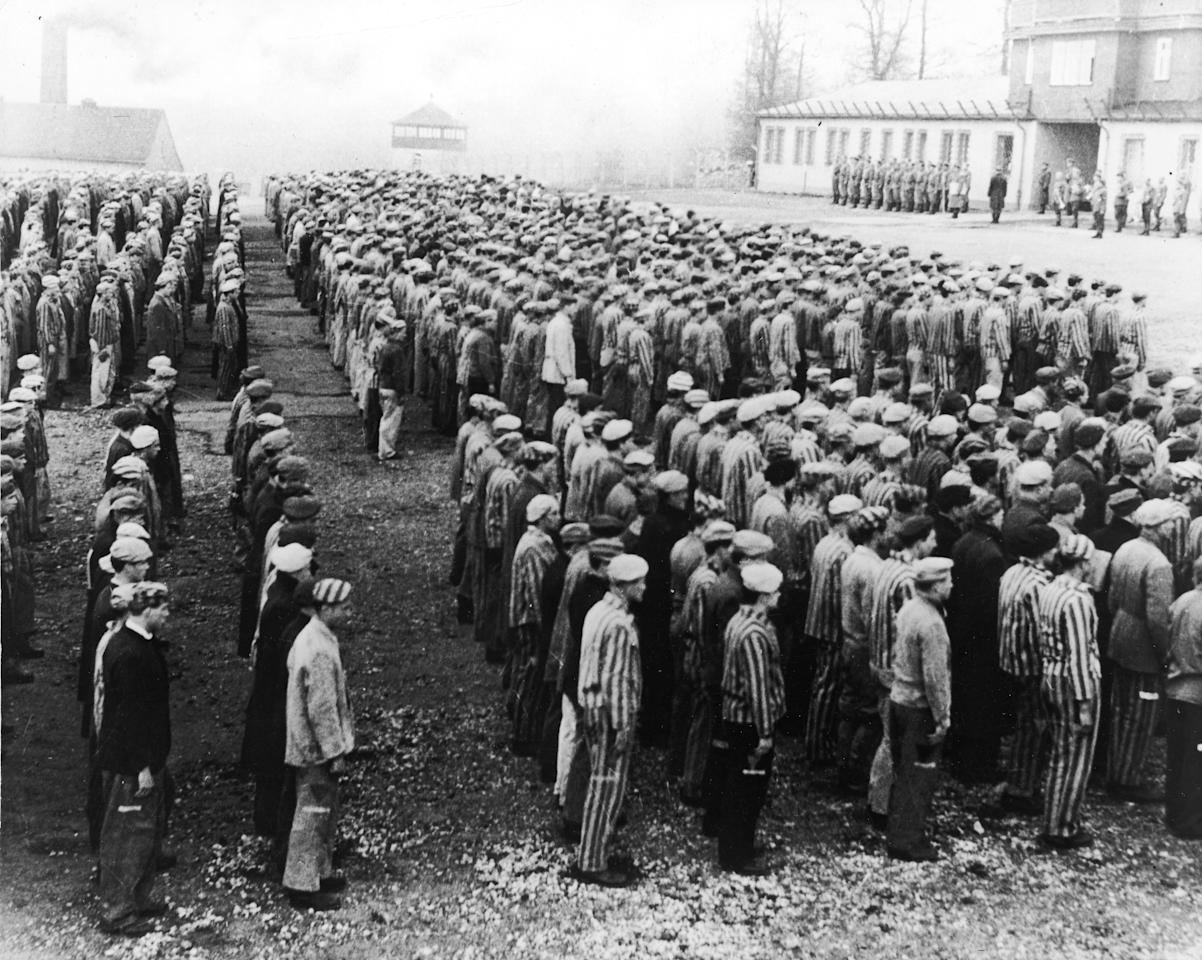 High-angle view of Polish prisoners in striped uniforms standing in rows before Nazi officers at the Buchenwald Concentration Camp, Weimar, Germany, World War II, circa 1943. (Photo by Frederic Lewis/Getty Images)