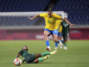 Zambia's Ireen Lungu, bottom, and Brazil's Andressa battle for the ball during a women's soccer match at the 2020 Summer Olympics, Tuesday, July 27, 2021, in Saitama, Japan. (AP Photo/Martin Mejia)