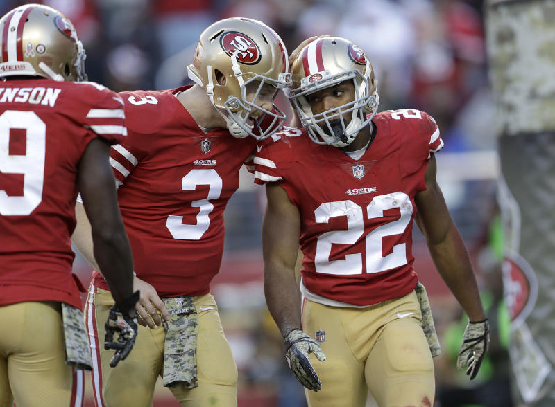 San Francisco 49ers running back Matt Breida (22) is congratulated by quarterback C.J. Beathard (3) after scoring a touchdown. (AP)