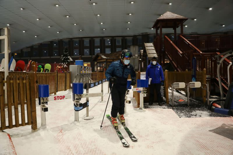 A man wearing a protective face mask gets ready to ski at Ski Dubai during the reopening of malls, following the outbreak of the coronavirus disease (COVID-19), at Mall of the Emirates in Dubai