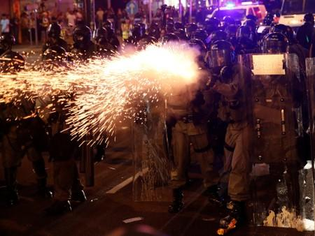 Riot police clash with anti-extradition demonstrators, after a march to call for democratic reforms in Hong Kong
