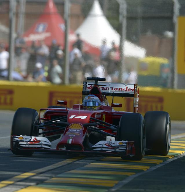 Ferrari driver Fernando Alonso of Spain controls his car on turn three during the first practice session for the Australian Formula One Grand Prix at Albert Park in Melbourne, Australia, Friday, March 14, 2014. (AP Photo/Ross Land)