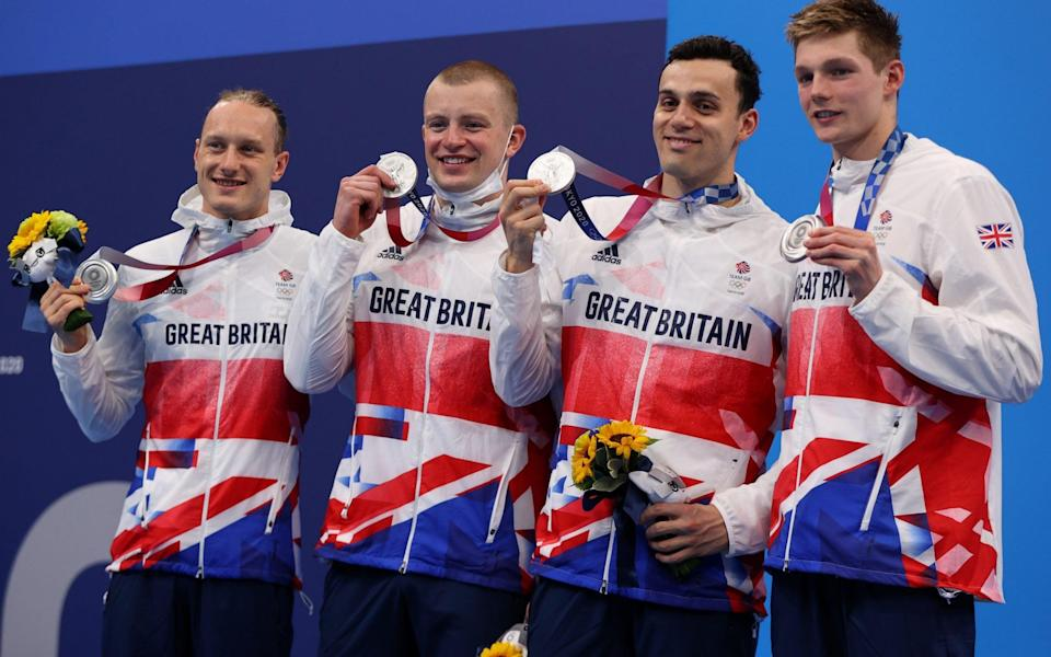 Tokyo, Japan - August 1, 2021. Luke Greenbank of Britain, Adam Peaty of Britain, James Guy of Britain and Duncan Scott of Britain pose with their silver medals