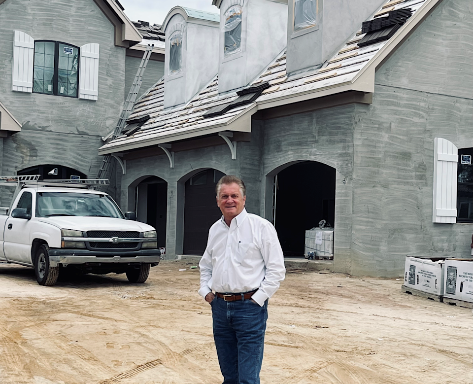 Chuck Fowke outside a home he's building in Florida